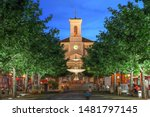 Night scene in Place de Marche, Carouge, Geneva, Switzerland with the Church of Sainte-Croix overlooking the square.