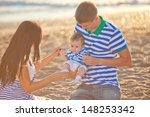 happy young family have fun on... | Shutterstock . vector #148253342