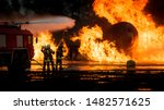 Small photo of Fire fighting team fights valiantly to extinguish an inferno in an plane crash exercise