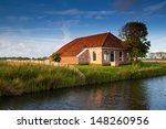charming farmhouse by river in... | Shutterstock . vector #148260956