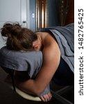 A Woman Lies On A Massage...