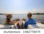 Young couple boating on a motor ...