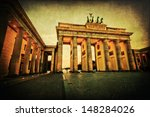the famous Brandenburg Gate in Berlin, Germany, at night with vintage style texture - stock photo