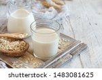 Small photo of Vegan oat milk, non dairy alternative milk in a glass close up