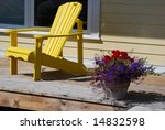 Yellow chair and a flower pot - stock photo