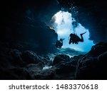 divers inside a cave entrance | Shutterstock . vector #1483370618
