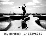 A Silhouette Of A Skateboarder...