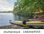 Two kayaks resting on a remote beach in the Linnansaari National Park