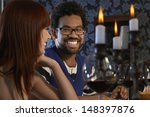 smiling young couple looking at ... | Shutterstock . vector #148397876