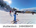 People Skiers skiing in Zillertal Arena ski resort in Tyrol in Mayrhofen of Austria in winter Alps. Ski in Alpine mountains with white snow and blue sky. Austrian snowy slopes. Sun shining.