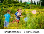 happy children in a clearing... | Shutterstock . vector #148436036