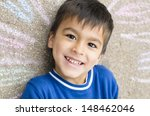 happy boy with his drawing on... | Shutterstock . vector #148462046