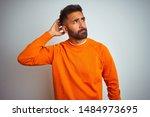 Young Indian Man Wearing Orange ...