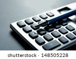pen and calculator on business... | Shutterstock . vector #148505228