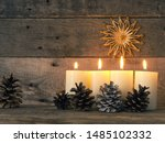 Small photo of Four Advent candles are burning, fourth Advent candle burns, Christmas concept