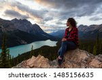 Adventurous Girl Sitting On Th...