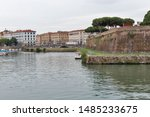 Livorno cityscape with canal, New Fortress and Republic Square, Italy.