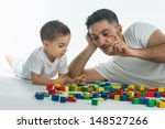 Father And Son Playing With...