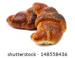 Image of croissant with poppy. - stock photo