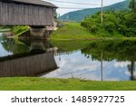 A Covered Bridge Reflected In ...