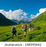 young hikers trekking in... | Shutterstock . vector #148595642