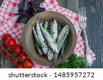 Stock photo baltic herring seafood salted herring fish in a bowl with spices and herbs wood background 1485957272