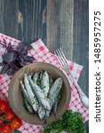 Stock photo baltic herring seafood salted herring fish in a bowl with spices and herbs wood background 1485957275