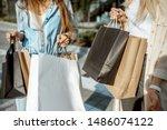 Women Holding Shopping Bags...