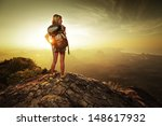lady hiker with backpack... | Shutterstock . vector #148617932