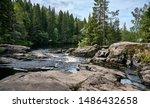 River Flows Over Rocks Through...