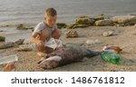 A little boy removes plastic...