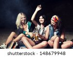 Three Woman Drinks Beer On The...