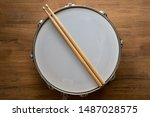 Drum Stick And Drum On Wooden...
