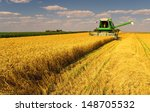 combine harvester harvesting... | Shutterstock . vector #148705532