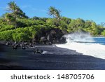 Black Sand Beach With Crashing...