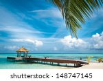 Maldivian House On A Tropical...