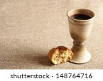 chalice with wine and bread.... | Shutterstock . vector #148764716