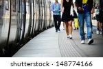 Passengers and commuter train - stock photo