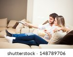 young couple preparing to watch ... | Shutterstock . vector #148789706