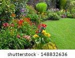Stock photo green lawn in a colorful landscape formal garden beautiful garden 148832636