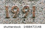 The year 1991 chiselled out of granite and polished – a detail of an inscription produced that year