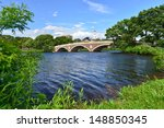 Stock photo john w weeks bridge over charles river and clock tower in harvard university campus in boston ma 148850345
