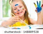 Little Girl Painting With...