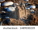 Sandcastle On The Beach In...
