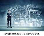 Small photo of Image of young businessman standing against business sketch