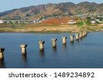 North Korea. Construction of a bridge across the Ryesong river and coastal urban-type settlement near Wonsan