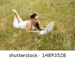 beauty woman with laptop on the grass - stock photo