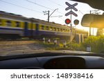railway crossing in sunset with ...