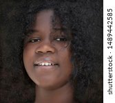 Small photo of Close-up portrait of a voluptuous girl with kinky hair