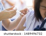 the nurse is injecting anti...   Shutterstock . vector #1489496732